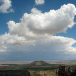 Photo of large cloud above butte