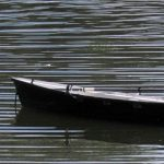 Photo of rowboat on rippled water