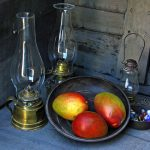Photo of mangos, iron dishes, marbles, hurricane lamps
