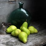 Photo of pears, antique handbell, green glass bottle