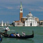 Photo of gondola rowing through Venice