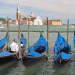 Photo of docked gondolas in Venice