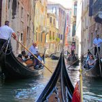 Photo of gondolas passing each other in Venice